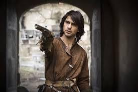 Luke Pasqualino as d'Artagnan (sans chapeau)